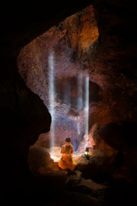 Monk In Cave by Tippawan Kongto